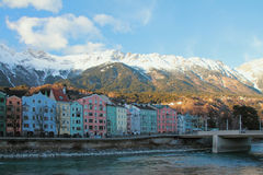 Street of multi-colored houses at foot of mountains. Innsbruck, Austria Royalty Free Stock Images