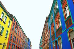 Street with multi colored painted houses in Magdeburg, Germany stock images