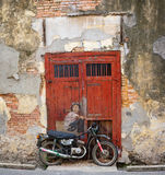 Street Mural 'Boy on a bike' painted by Ernest Zacharevic Stock Photo