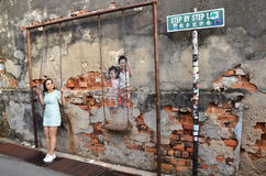 Street Mural tittle Children on the Swing painted by Louis Gan i. PENANG, MALAYSIA- 29 DECEMBER, 2016: Street Mural title Children on the Swing painted by Louis Stock Photos