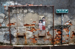 Street Mural tittle Children on the Swing painted by Louis Gan i Royalty Free Stock Photo