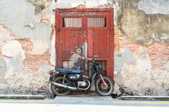 Street Mural tittle painted by Ernest Zacharevic in Penang. PENANG, MALAYSIA-Sep 6 : Street Mural tittle painted by Ernest Zacharevic in Penang on Sep 6, 2015 Royalty Free Stock Photos