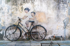 Street Mural tittle painted by Ernest Zacharevic in Penang. PENANG, MALAYSIA-Sep 6 : Street Mural tittle painted by Ernest Zacharevic in Penang on Sep 6, 2015 Royalty Free Stock Photography