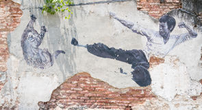 Street Mural tittle painted by Ernest Zacharevic in Penang Stock Images