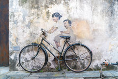 Street Mural tittle painted by Ernest Zacharevic in Penang. PENANG, MALAYSIA-Sep 6 : Street Mural tittle painted by Ernest Zacharevic in Penang on Sep 6, 2015 Royalty Free Stock Images