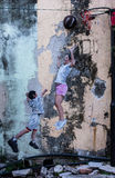 Street Mural tittle. PENANG, MALAYSIA-FEB 14: Street Mural tittle 'Little Children on a Bicycle' painted by Ernest Zacharevic in Penang on Feb.14, 2012. It was Royalty Free Stock Images