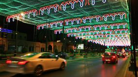 Street in Muscat with chains of lights. MUSCAT, OMAN - NOV 24: Street in Muscat decorated with chains of lights for celebration of the 45th National Day of Oman stock footage