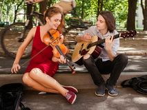Street music duo performance romance freedom. Street music duo group performing in a park. free spirits hippie romance concept Stock Image