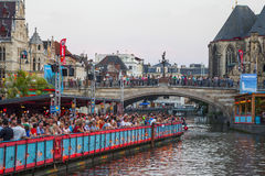 Street music festival Gent Fest 2014. Ghent, Belgium - July 23 2014: Panton platform on the waterfront of the River Lis with which viewers are watching one of Royalty Free Stock Photography