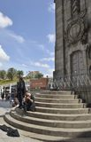 Street music from University students. University students playing instruments and singing nexto to the Clerigos tower in Porto, Portugal royalty free stock photos