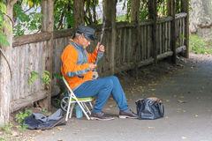 Street musicial playing the banjo in Central Park Stock Photos