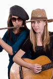 Street musician. Two girls with flute and guitar Stock Photo