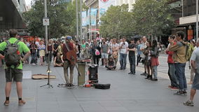Street musician and audience in Melbourne stock video footage