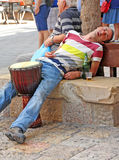 Street Musician On Break Stock Photo