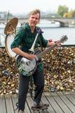 Street musician busker entertain public on Pont des Arts in Paris Stock Image