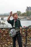 Street musician busker entertain public on Pont des Arts in Paris Royalty Free Stock Image