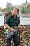 Street musician busker entertain public on Pont des Arts in Paris Stock Photo
