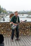 Street musician busker entertain public on Pont des Arts in Paris Stock Photos
