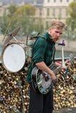 Street musician busker entertain public on Pont des Arts in Paris Stock Photography