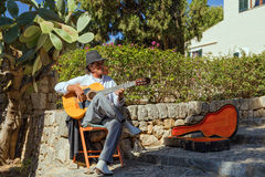 Street Musician (Busker), Pollensa, Mallorca. Street Musician playing traditional Spanish guitar music on the Calvari steps in Pollensa, Mallorca Royalty Free Stock Photo