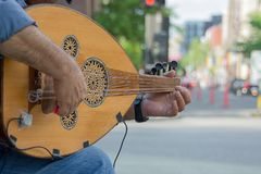 Street musician busking in the city for money. And fun stock photo