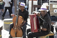 Street musician in Cape Town. A cellist and a accordionist locals musician in the waterfront in Cape Town stock photos