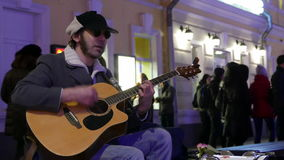 Street musician in the center of Moscow sings and plays guitar and drums. stock video