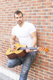 Street musician with cflassic guitar. Royalty Free Stock Images
