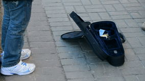 A street musician collects money stock video footage