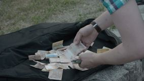 Street musician count money. Performer guitarist stock footage