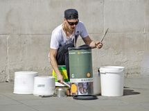 Street musician drumming Royalty Free Stock Image