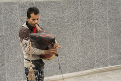 A street musician entertain people in front of metro station by. Tehran, IRAN - May 2, 2017 a street musician entertain people in front of metro station by stock image