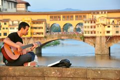 Street musician in Florence city , Italy. Street musician , artist playing beautiful songs in Florence, Italy. urban artist playing music on his guitar stock photos