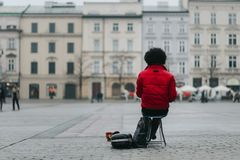 Street musician with flute trying to earn some money stock photo