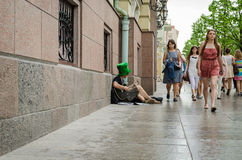 Street musician green hat play street with guitar Royalty Free Stock Images