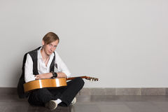 Street musician with a guitar. Royalty Free Stock Photos