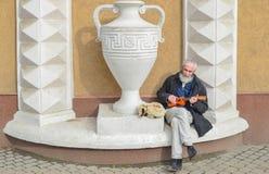 Street musician - guitarist. Elderly man earns money Royalty Free Stock Photography