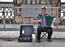 Street musician - harmonist Royalty Free Stock Photography