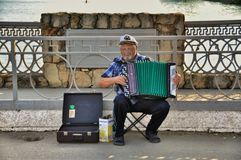 Street musician - harmonist Royalty Free Stock Photos