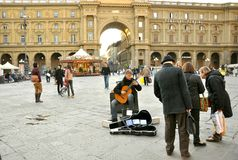 Street musician in Italy. Street musician playing beautiful songs in Florence, Italy. urban artist playing music on his guitar royalty free stock photos