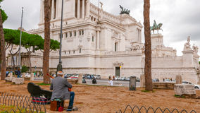 Street musician at National Monument Viktor Emanuel II in Rome stock photography