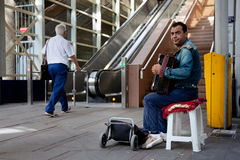 Street musician near stairs to shopping centre Royalty Free Stock Photo