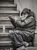 Street Musician. New Yor City, USA - April 1, 201: A street flute player at the Wall Street Stock Image