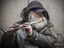 Street Musician. New Yor City, USA - April 1, 201: A street flute player at the Wall Street Royalty Free Stock Images