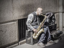 Street Musician. New york city, USA - April, 02 2013: American man playing saxo in Fifth Ave Stock Photos