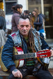 Street musician on the one of the streets in the historical centre of Porto old town. Royalty Free Stock Image