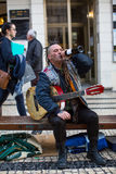 Street musician on the one of the streets in the historical centre of Porto old town. Royalty Free Stock Photography