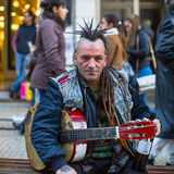 Street musician on the one of the streets in the historical centre of Porto old town. Stock Photos