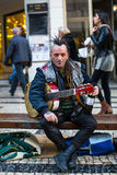 Street musician on the one of the streets in the historical centre of Porto old town. Royalty Free Stock Images