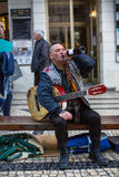 Street musician on the one of the streets in the historical centre of Porto old town. Royalty Free Stock Photo